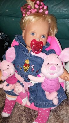 Boo Boo Lucy with her piglet dress and her piglet dolls.....2/12/17
