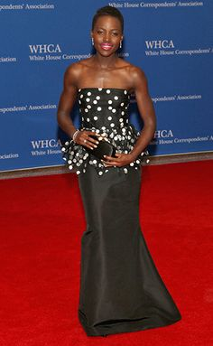 Lupita Nyong'o stuns in a black and white polka dotted Oscar de la Renta dress at the White House Correspondents' Dinner