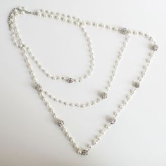 """Smokey Rose by TuVous - $15.00  This triple layered pearl necklace will bring a graceful style to any outfit with its petite pearls accented with delicate spheres of intricate silver mingled with dainty orbs of shimmering sparkle. -""""20 ½ + """"3 extender (""""20 ½ first layer """"34 third layer)   Available at www.stylishvous.com"""