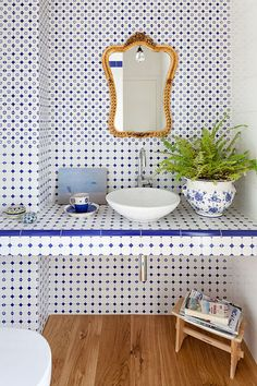 If you have a tile pattern you love enough, that it will stand the test of time. This kind of blue (or the turquoise) is so classic that is can almost be a neutral.   Stunning penthouse flat in Italy: Casa F/H