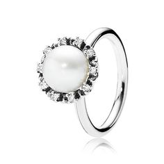 Inspired by vintage glamor, the romantic ring design with a large freshwater cultured pearl and a halo of sparkling stones will be an instant upgrade of any outfit. $35 #PANDORA #PANDORAring