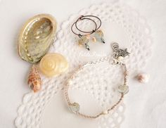 Petite Fraise Handmade: Quiet morning on the beach  Jewelry set, earrings + friendship bracelet   #etsy #handmade #jewelry #earrings #friendship #bracelet #seaside #summer #sand #beach #aqua #lampwork #seaglass #shell
