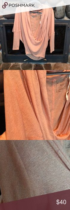 Beautiful Free People peach/light orange top open front top, long in the back. wear off the shoulder or on both shoulders.  🍑🛒 very beautiful material, hardly worn.  🖤animal-smoke-free environment 🖤bundle and save Free People Tops Blouses