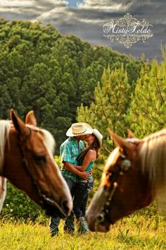 I don't know how the heck I'm gonna get this pic with my stubborn horses but I have to have it for one of my engagement pictures