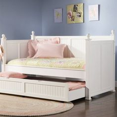 Featuring simple molding and a classic round finials, this versatile daybed with trundle can create a lovely reading nook in your master suite or use it for extra slumber space in your children's bedroom.