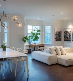 Modern Living Room Design:  white architectual sofa and Kartell Masters Chairs in dinning room