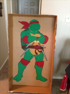 Boyfriend and I made this from a box and acrylic paint for my nephews tmnt birthday party. We cut a hole out in the head and took pictures with the guests' faces in it- huge hit!