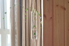 Hanging cylindrical glass vaseindoor water by NewDreamWorld