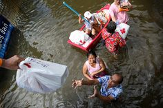 Flood survivors receiving supplies from the Thai Red Cross, having been cut off by the flood waters for at least two weeks.    Photo: Félix Genêt Laframboise/IFRC