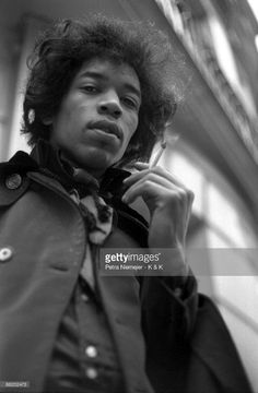 1967: Photo of Jimi HENDRIX; posed, looking to camera, holding cigarette