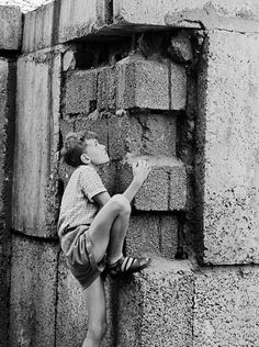 Playing on the Berlin Wall, 1963.