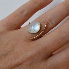 A high quality AAA Rainbow Moonstone is set into Sterling Silver bezel and sits on a 14K Gold Filled band.  I make this to order in any ring