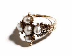 Made in between 1790 and 1820, this beautiful Georgian style setting is done in 18k gold with natural pearls.