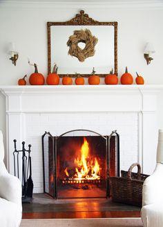 Roaring fire, white mantle, pumpkins & wheat stock wreath, autumn decor