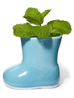 Make rainy days a bit brighter by placing these adorable planters outside your home! #flowers #outdoordecor
