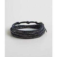 Chan Luu Gunmetal bead and dark blue leather wrap bracelet ($70) ❤ liked on Polyvore featuring jewelry, bracelets, dark blue, beaded jewelry, boho jewelry, leather bangle, leather wrap bracelet and bohemian wrap bracelet