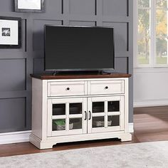 Coventry Console with Multi-Step Sherwin-Williams Finish (This is the one we decided on, it looks fabulous and only $299.00 at Sams. Lots of compliments already. Works with our 4k Sony TV centered in the middle.