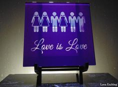 """""""Love is Love"""" Etched Glass Purple Wall Tile Trivet Etched Wine Glasses, Etched Glass, Glass Etching, Mosaic Glass, Glass Art, Purple Walls, Beer Mugs, Champagne Flutes, Glass Candle Holders"""