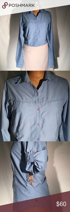 The North Face vented side lg slv button-up shirt The North Face ocean blue long sleeve shirt, but button-tab rollable sleeve with side vent. Vents have Velcro in closed & opened position so that you can breathe. Diagonal breast pockets, pink logo buttons, fitted. Made in China. Size X-Large. Nylon 27% & poly 73%. PM748 The North Face Tops