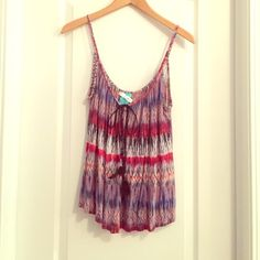 Gorgeous Soft Boho Printed Top Super soft and comfy beautiful printed flowy HIP (Happening In the Present) tank top with a faux suede tie with feathers and beads on the ends. In perfect condition. Worn once and I had it dry cleaned. The tag on the shirt is from the cleaners and I'll leave that for you to take off so you know it's be freshly dry cleaned and ready for you to wear! Size XS, but will also fit an S. HIP Tops