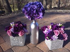 Purple flowers, centerpieces, silver wine bottles, purple hydrangea, rhinestone wrapped vases