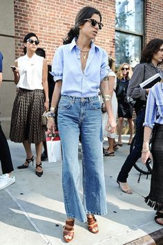 Leandra Medine never fails to impress us with her ultra chic street style and this look is certainly no exception. Her cropped wide-leg jeans look ultra-cool paired with a blue button-down shirt, strappy heeled sandals and shiny stacked gold bracelets.