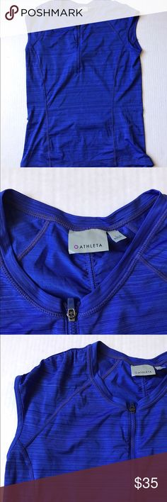 ATHLETA Pacifica UPG Tank 2 Caspian Blue Fitted. Sits next to skin without being too tight. Made from UPF 50+ rated fabric sleek, wicking and keeping fresh for long days out out on the water. Half zip front for ventilation. Cap sleeve. Rear zip pocket stashes your stuff. Ultra flattering seam lines puts the best you forward. Ready for all summer activities!!! Non smoking home. Thank you for your visiting my closet. If you have any questions please let me know. Thank you 😊! Athleta Tops