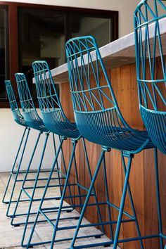 Bold blue modern wire & metal bar stools featured in: A Bold Bachelor Pad in Austin // ruemag.com