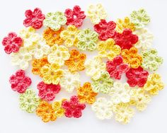 Crochet Flowers by annemariesbreiblog on Etsy, €4.50 - I really love these and I think using crochet in jewelry is hot!