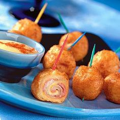 Serve these with a dusting of powdered sugar and a little raspberry jam for dipping...yum yum.  Miniature Monte Cristos