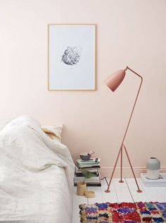 Cozy bedroom with a peach pink accent wall design | weekend at home