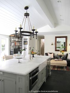 kitchen island with microwave, prep sink and dishwasher.  Nice cozy sitting area for coffee and tea.