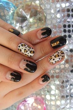http://static.becomegorgeous.com/img/arts/2012/May/22/7869/animal_print_nail_design.jpg
