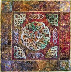 Sara's Circle Knot quilt features painted Celtic designs in the background.