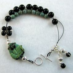 Alley Cat - Dual Purpose Stitch Marker Holder and Abacus Row Counter Bracelet - Item No. 858. $12.99, via Etsy.