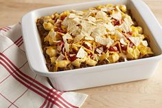This VELVEETA Nacho Bake is hearty with salsa, sour cream and ground beef—all covered with a topping of cheesy crushed tortilla chips.