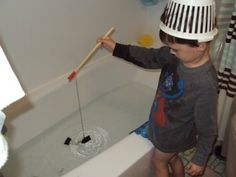 Bath time fishing with a magnet and paper clip. Homemade fun!