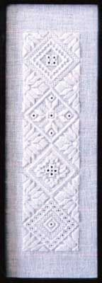"This is the first in a series of three designs which all use the same diamond layout. Stitch the design as shown or use the individual diamonds for ornaments or on other whitework projects.  Stitch count is 60 x 240 with a design size of 2.125"" x 8.5"". Supplies required:  28-count White Cashel (3281-100)   DMC Size 8 Pearl Cotton: White"