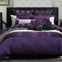 Rich and elaborate, the ornate Carla is an elegant and regal quilt cover set featuring a distinctive colour palette of black, silver grey and royal purple. Horizontal feature panels bring together pleating, prints, lush velvet and decorative flocking to produce a sumptuous bedroom design that combines a majestic look with a luxurious texture and feel.