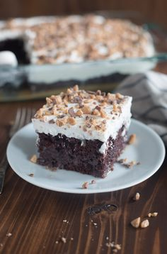"""Better than Anything Cake made with homemade caramel sauce and fresh whipped cream. This recipe is one of our favorite cakes, ever! Please tell me you've heard of this cake before? Some people refer to it as """"Better than Sex"""" Cake, but we call it Better than Anything Cake! If you're familiar with traditional recipes, …"""