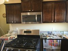 Dark cabinets and DYI mother of pearl kitchen backsplash. Kitchen Backsplash, Kitchen Cabinets, Kitchen Appliances, Mother Of Pearl Backsplash, Dark Cabinets, Dyi, Home Decor, Diy Kitchen Appliances, Home Appliances