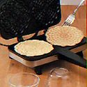 How to Make Ice Cream Bowls - 3 eggs, 3/4 cup sugar, 1/2 cup butter, melted, 2 teaspoons vanilla extract, 1-1/2 cups all-purpose flour, 2 teaspoons baking powder.  Drop 2 Tbs. batter into a hot pizzelle maker; cook until both sides are golden brown. Drape hot pizzelle over inverted custard cup; top with another inverted custard cup in form the bowl. Fill with ice cream.