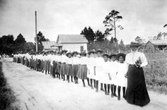Mary McLeod Bethune with girls from the Literary and Industrial Training School for Negro Girls in Daytona, Florida, circa 1905.