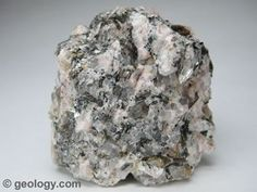 Pegmatite is an intrusive igneous rock with very large crystals that forms in the later stages of a magma chamber's crystallization. Minerals And Gemstones, Raw Gemstones, Rocks And Minerals, Large Crystals, Stones And Crystals, Formations Rocheuses, Igneous Rock, Rock Collection, Rocks And Gems
