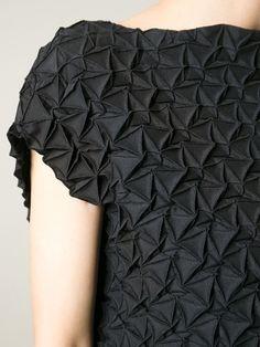 Textured dress with pleated patterns; fabric manipulation; geometric fashion details; origami fashion // Issey Miyake