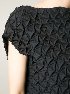 Textured dress with pleated patterns; fabric manipulation; geometric fashion details; origami fashion // Issey Miyake