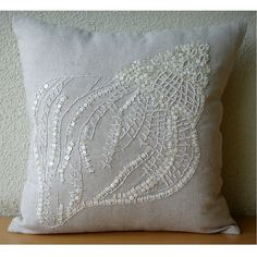 Sea Shell  - Throw Pillow Covers - 18x18 Inches Linen Pillow Cover with Pearl Embroidery. $31.75, via Etsy.