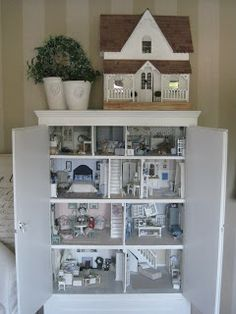 miniatyrmama: The dollhouse cabinet.  It closes to be a plain white cabinet with dollhouse inside. great for hiding my secret hobbie.
