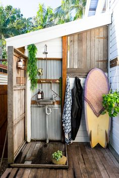a welcoming outdoor shower with corrugated steel, weathered wood and a surf boar. - a welcoming outdoor shower with corrugated steel, weathered wood and a surf board - Surf Shack, Beach Shack, Beach Cottage Style, Beach House Decor, Beach House Rooms, Style At Home, Outdoor Bathrooms, Outdoor Showers, Outside Showers