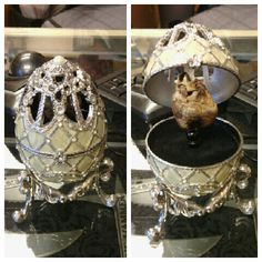 Faberge style egg with rhinestones and music box with a mummified cat heart